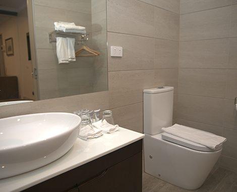 Deluxe Hotel Room Bathroom 1